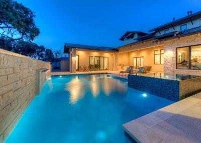 Custom Pool & Spa Designs - Photo at Dusk - Austin Texas