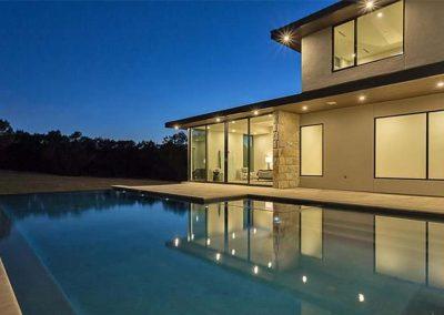 Night Photo - Custom Geometric Pool Design - Vanishing Edge - Austin Texas
