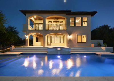 custom swimming pool design - night view - Westbrook Pools